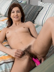 WeAreHairy — Atisha masturbates in bed with a favorite toy